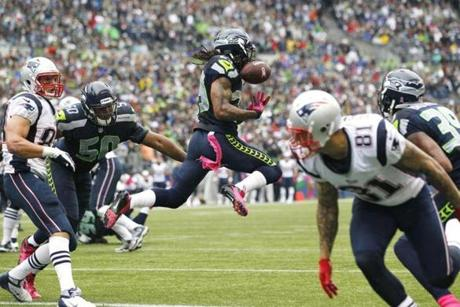 Seattle Seahawks' Earl Thomas breaks up a pass in the first half .